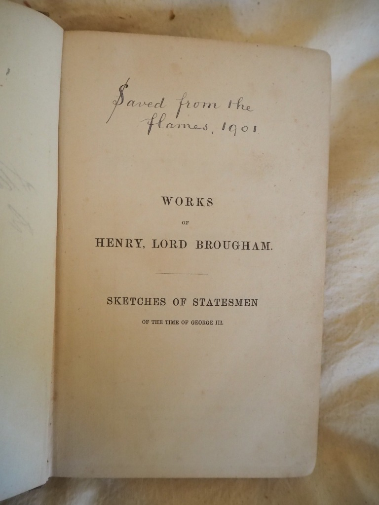 Photograph of the title page of 'Works of Henry, Lord Brougham: Sketches of Statesmen'. Above title handwritten inscription reads: 'Saved from the flames, 1901'.